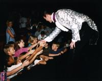 Lance Burton Master Magician greets the children after his show
