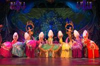 Dancers in Lance Burton's masked ball
